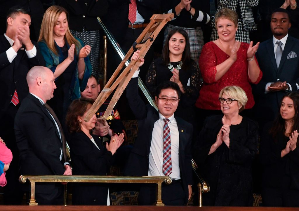 North korean defector raises his crutch at state of the union