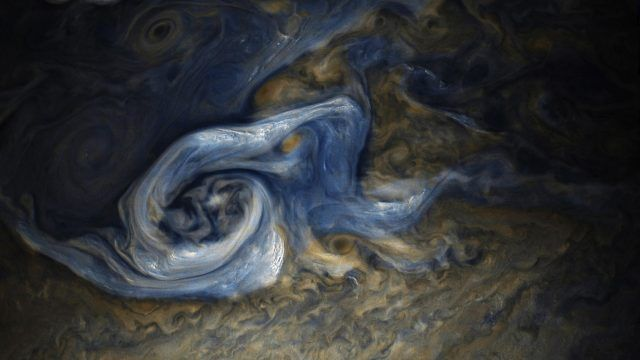 This color-enhanced image of a massive, raging storm in Jupiter's northern hemisphere was captured by NASA's Juno spacecraft during its ninth close flyby of the gas giant planet.