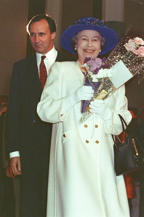 Paul Keating walking behind Queen Elizabeth.