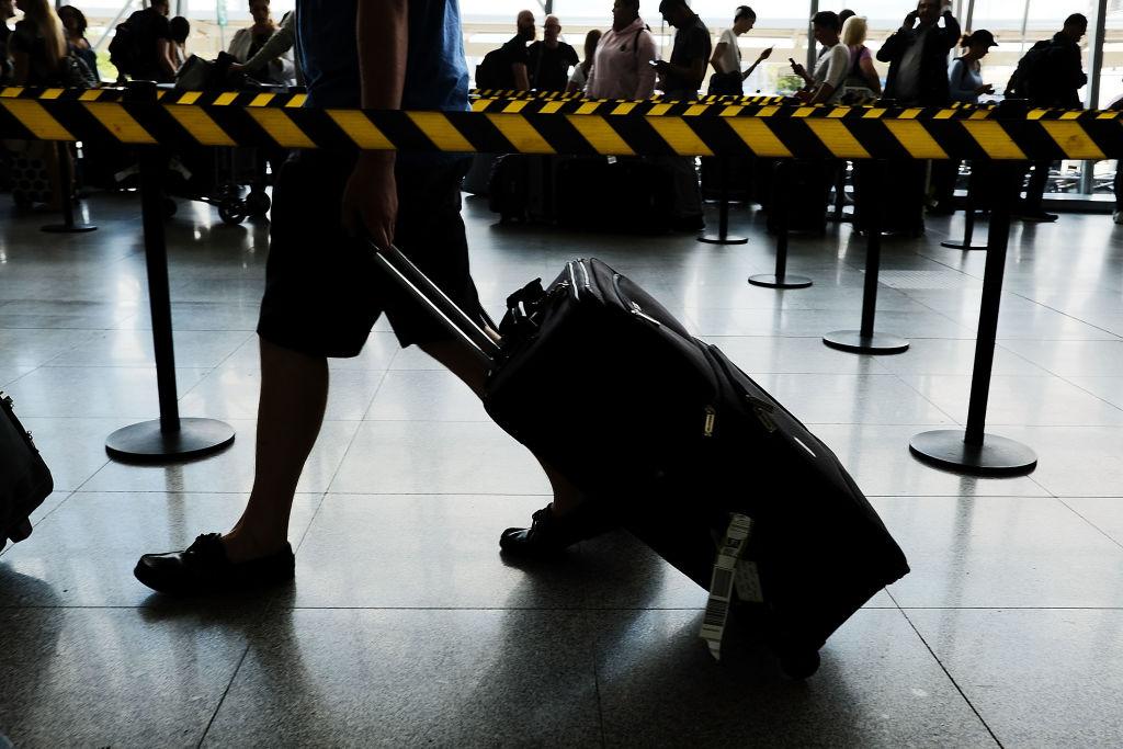 People arrive at John F. Kennedy (JFK) international airport