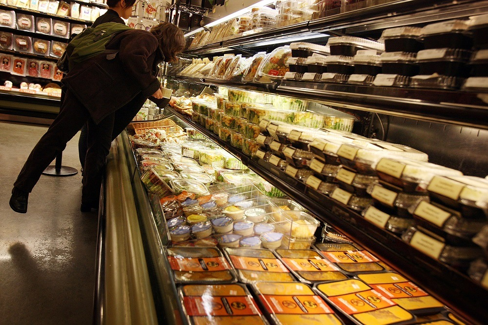 People shop at a Manhattan grocery store