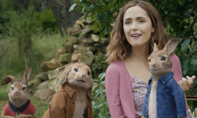 Peter Rabbit and his friends stand in the garden.