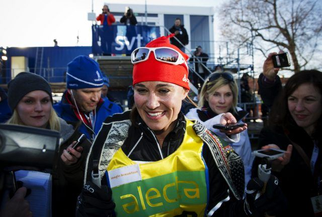 Pippa Middleton wears ski gear while being interviewed by reporters.