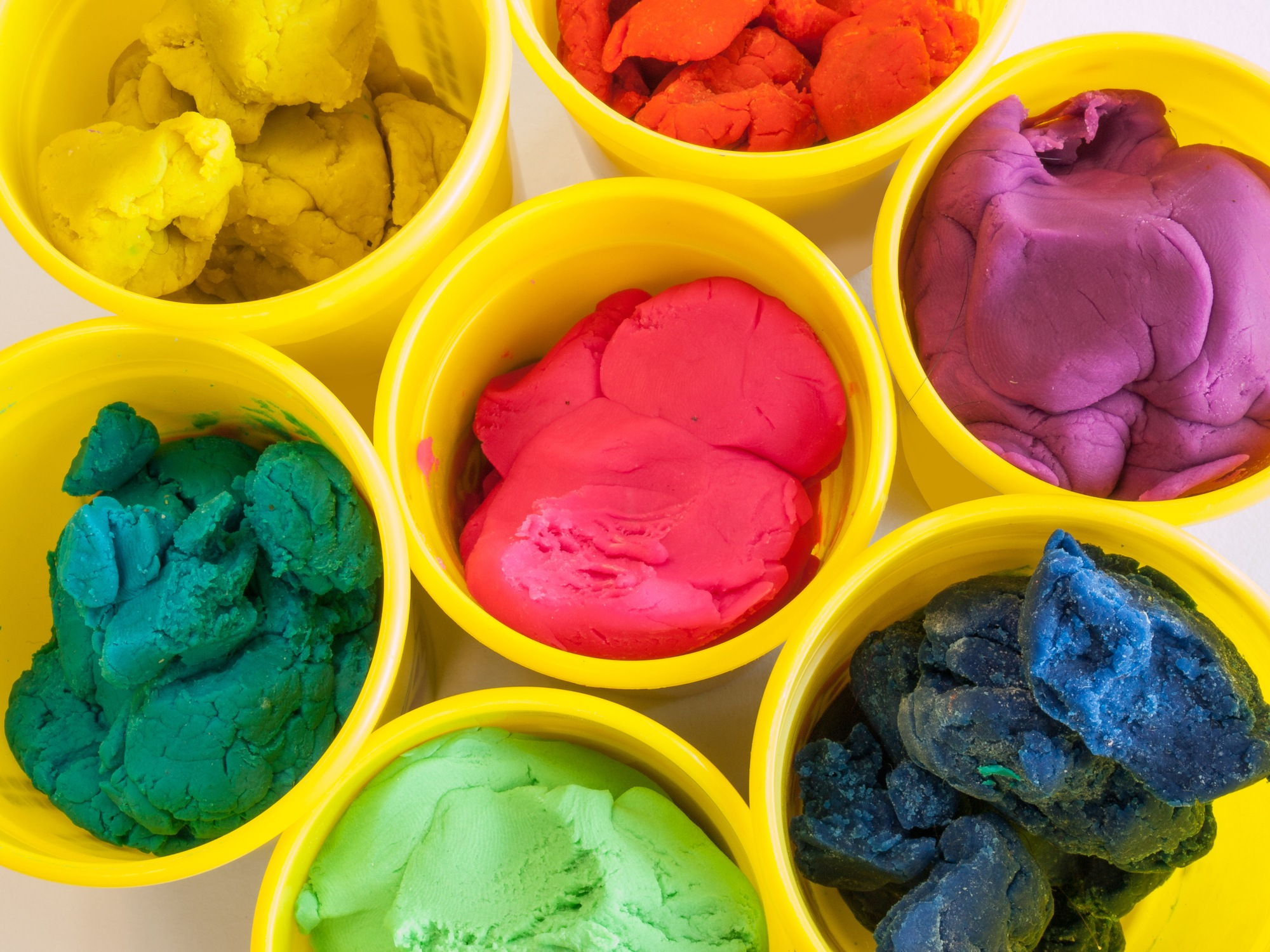 colorful play doh (dough( in yellow can