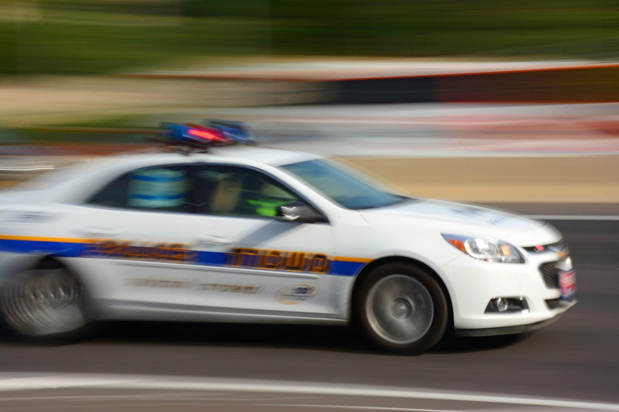Police car in motion