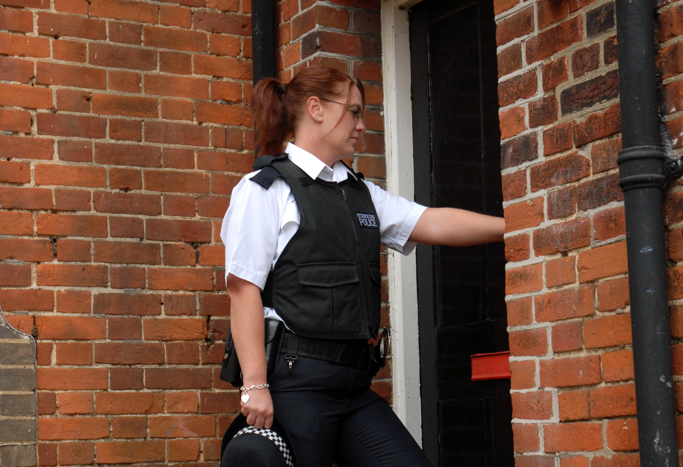 Female police officer knocking on door