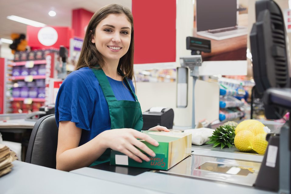 Portrait of woman cashier smiling at checkout
