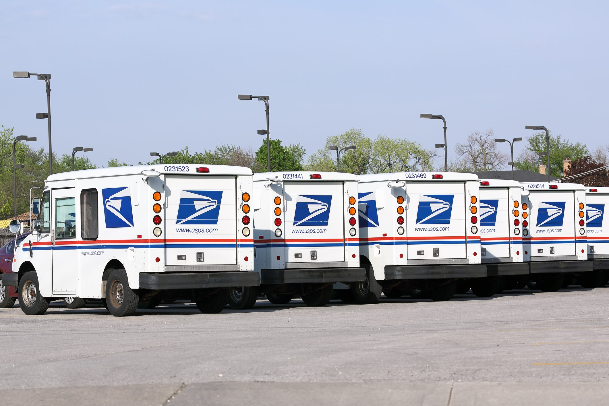 Fleet of USPS mail delivery trucks