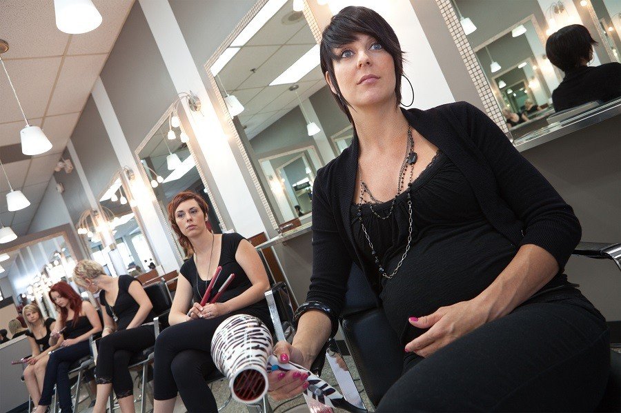 women working at a salon with no customers