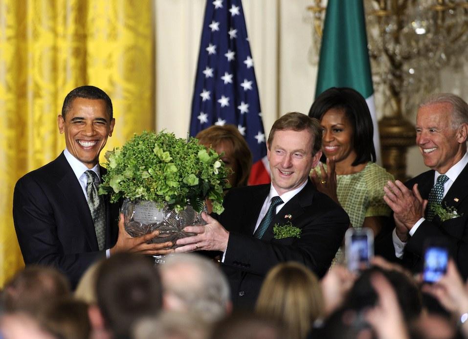 US President Barack Obama accepts a bowl of shamrocks from Irish Prime Minister Enda Kenny