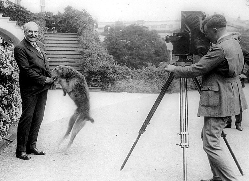 Warren Harding posing with his dog, Laddie