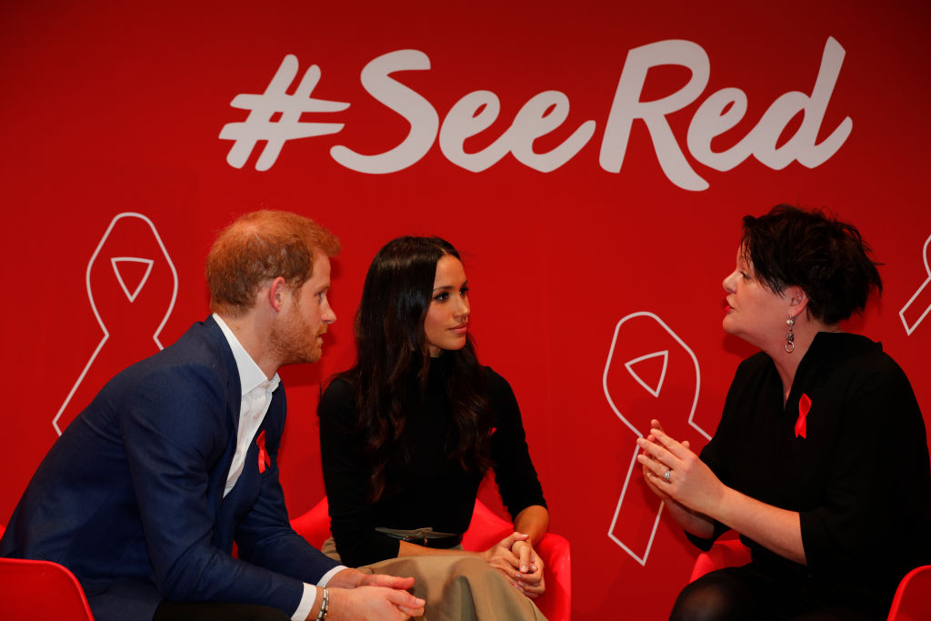 Britain's Prince Harry and his fiancee US actress Meghan Markle (C) take part in a discussion with HIV consultant doctor Laura Waters