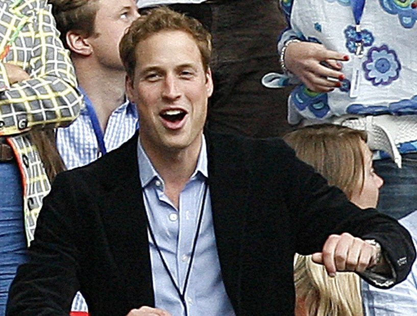 Prince William dances during a performance at Wembley stadium