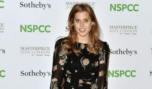 Princess Beatrice poses in a black floral dress.
