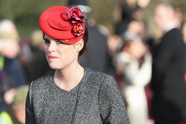 Princess Eugenie in a red hat.