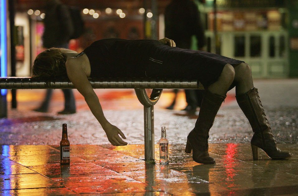 A woman lies on a bench after leaving a bar in Bristol City Centre