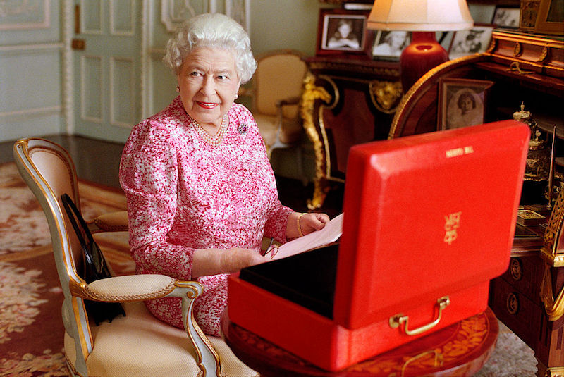 Queen Elizabeth II is seated at her desk in her private audience room at Buckingham Palace