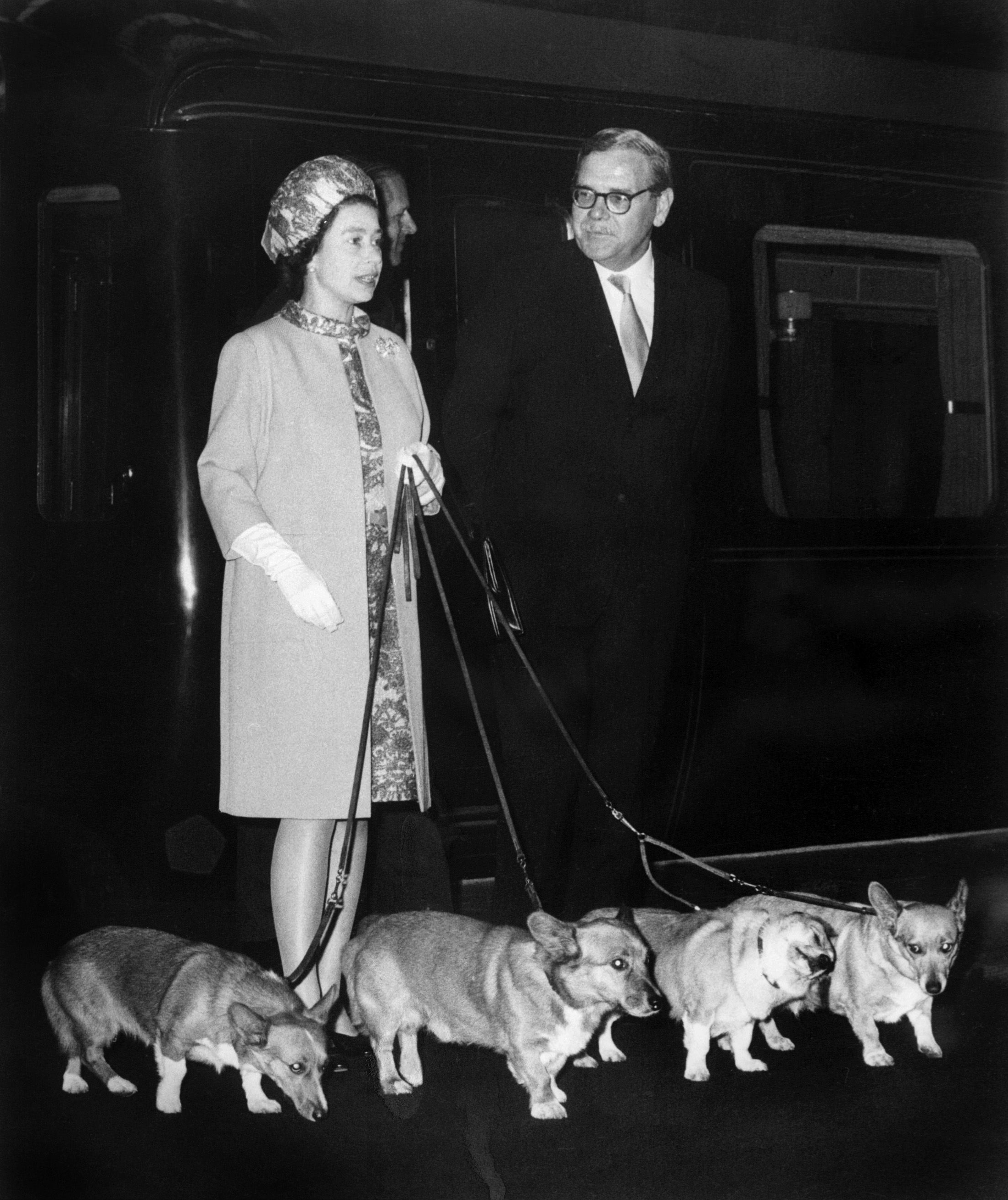 Queen Elizabeth II arrives at King's Cross railway with her corgis