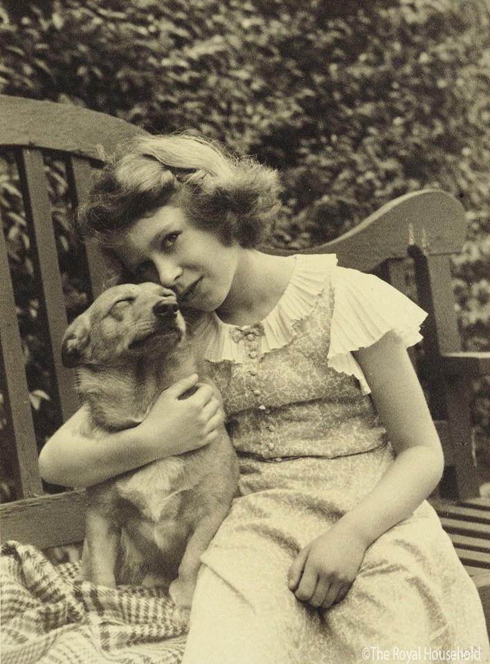 Queen Elizabeth young with her Corgi