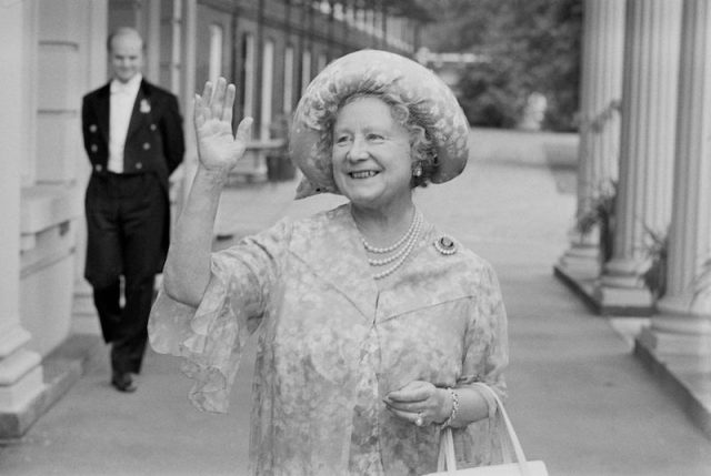 The Queen mother waving and smiling.