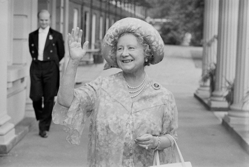 Queen Elizabeth, the Queen Mother (1900 - 2002), waves to the crowd who have gathered outside Clarence House, her London home, to wish her a happy 78th birthday, UK, 4th August 1978.