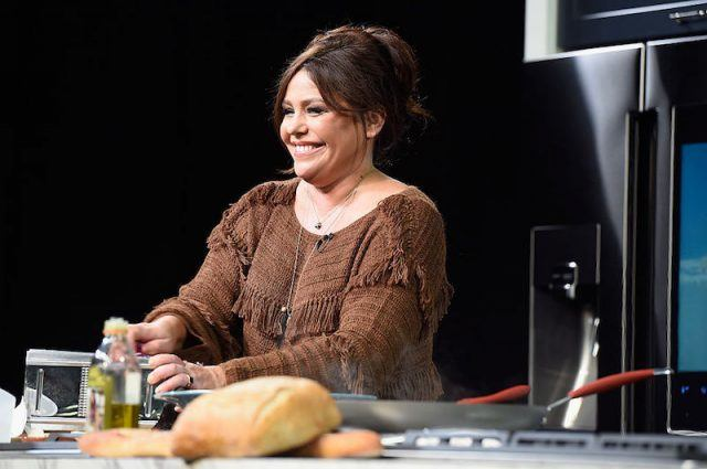Rachel Ray cooking at a counter.