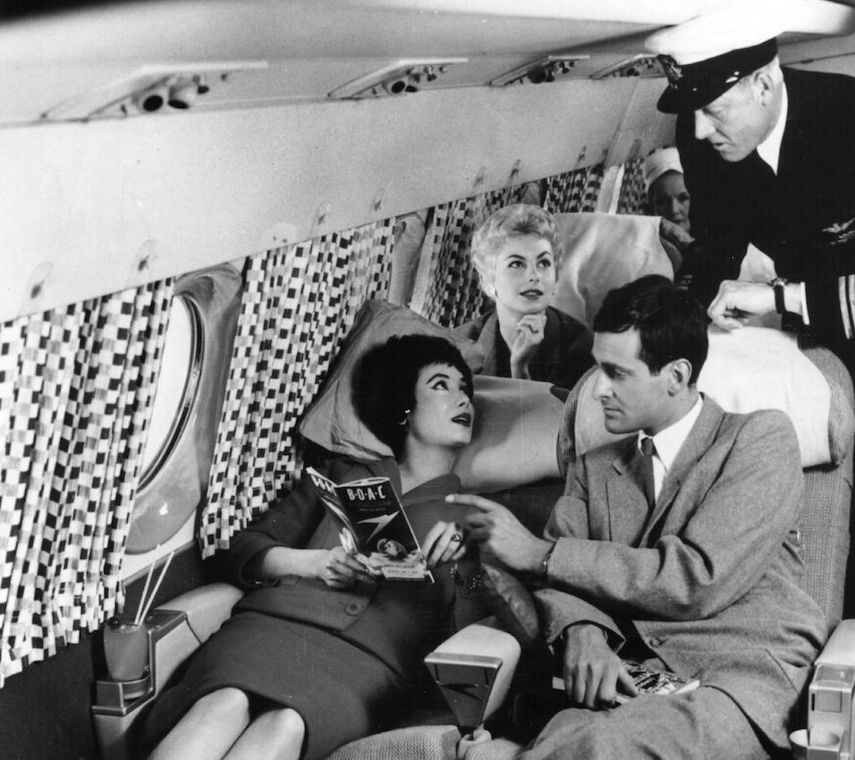 Passengers relaxing on the sleeper seats in the new Comet 4 during a demonstration flight at Hatfield