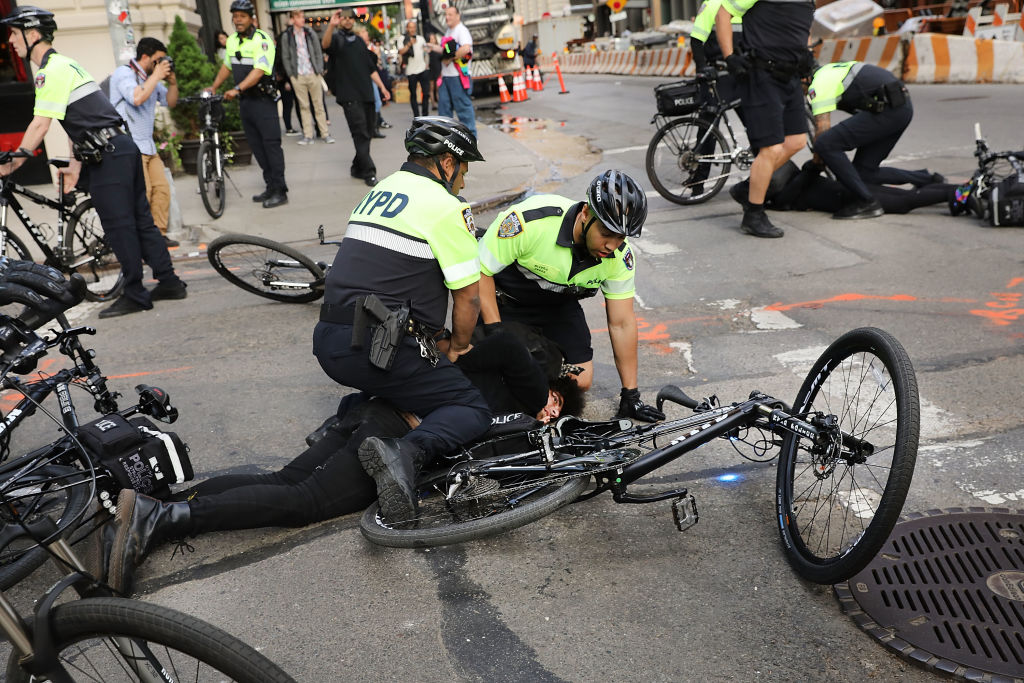 Man on the ground after Resisting arrest of police during a protest