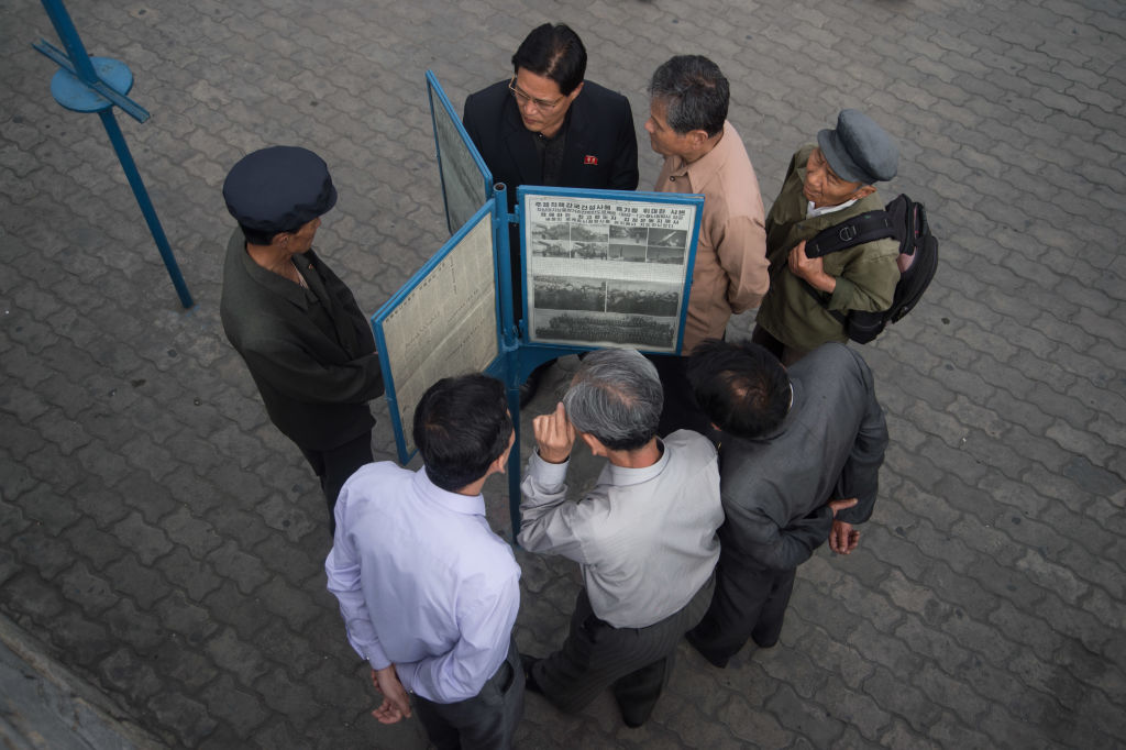 People read North Korean newspaper Rodong Sinmun