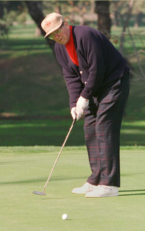 Former US President Ronald Reagan enjoys a round o