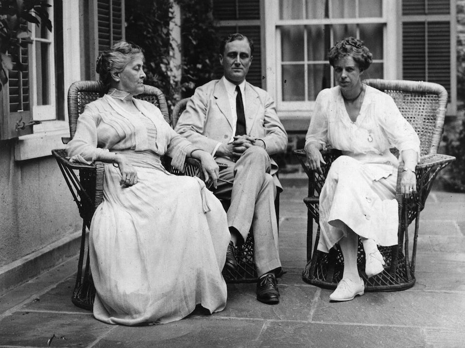 Franklin Delano Roosevelt the Democratic nominee for Vice-President, sits with his wife and mother at their home in Hyde Park,