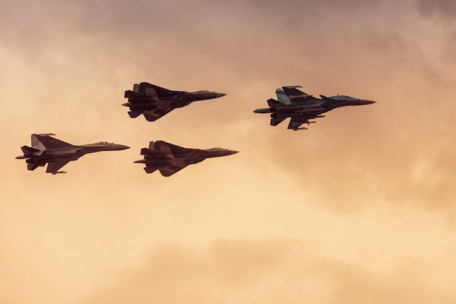 The SU-57s flying in the air.