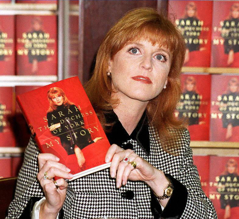 Sarah Ferguson, the Duchess of York, holds up a co