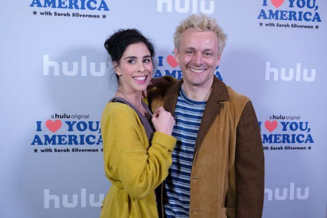 Sarah Silverman and Michael Sheen posing on a red carpet.