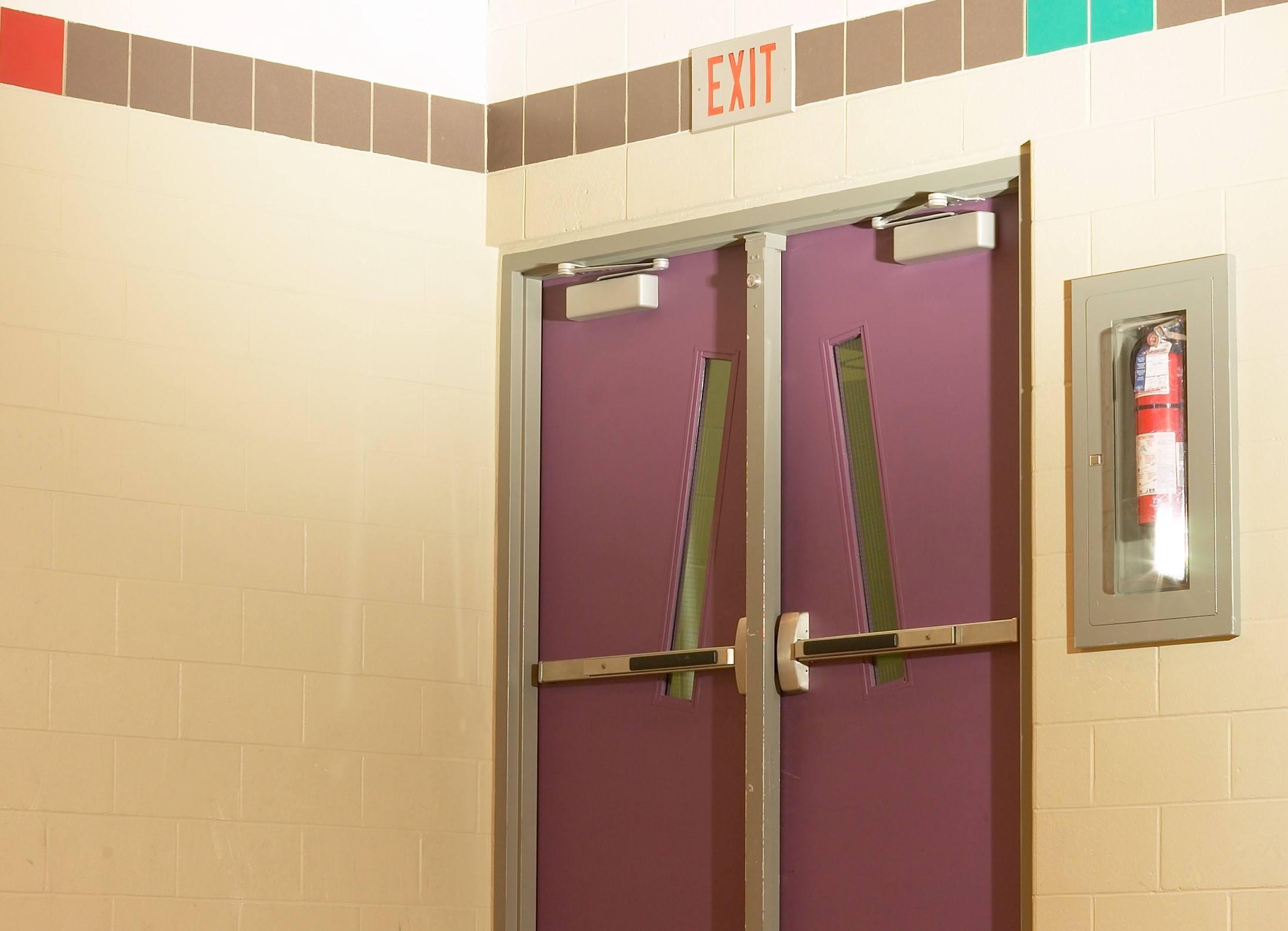 School door with fire extinguisher