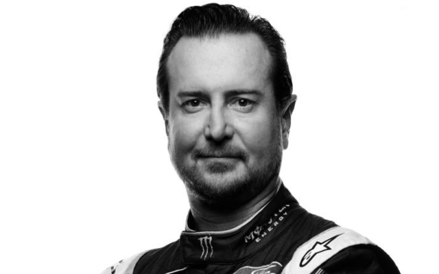 Kurt Busch posing in a black and white photo.