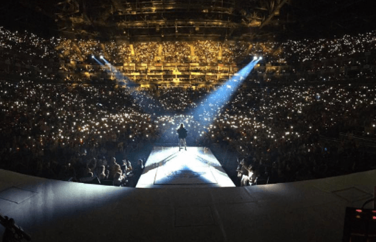 Taylor Swift performing at a concert.