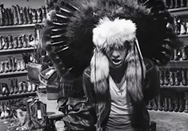 Harry Styles in Native American headdress.