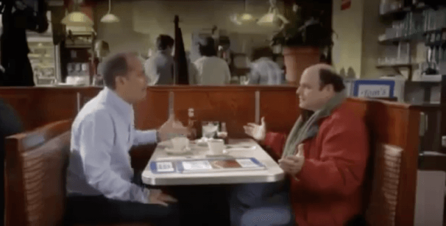 Jerry and George sitting together at a diner.