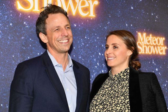 Seth Meyers and Alexi Ashe smiling brightly during an event.