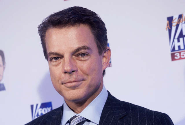 Shepard Smith smiling while on a red carpet.