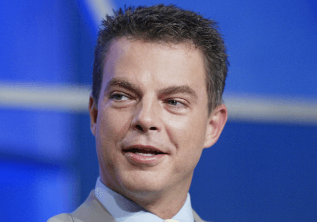 Shepard Smith wearing a gray suit and light blue shirt during an interview.