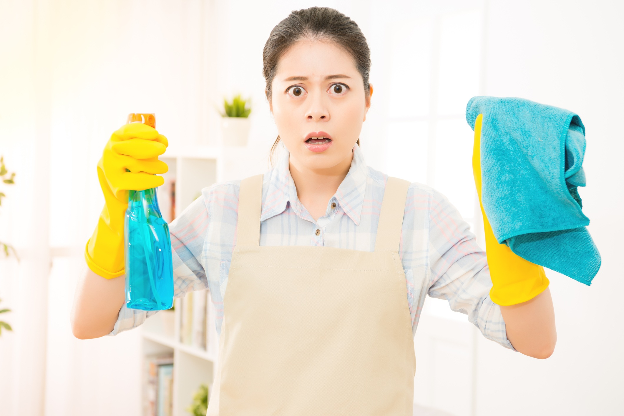 shocked housewife cleaning window