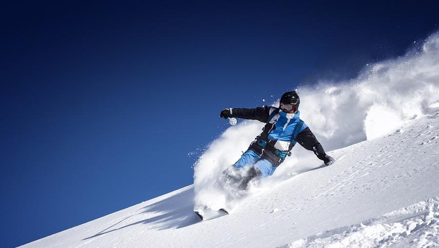 man skiing through the mountains