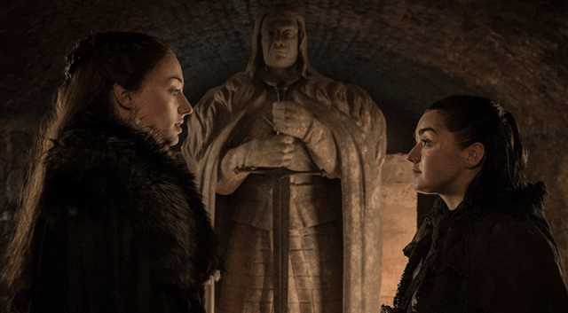Maisie Williams and Emilia Clarke face each other in 'Game of Thrones'.