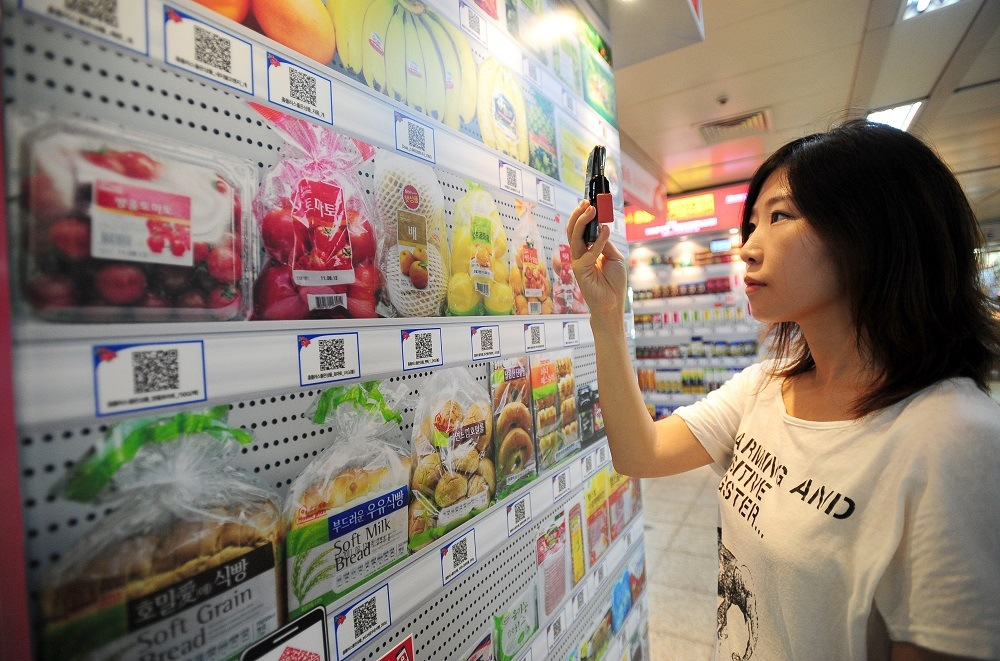 woman using cell phone in super market