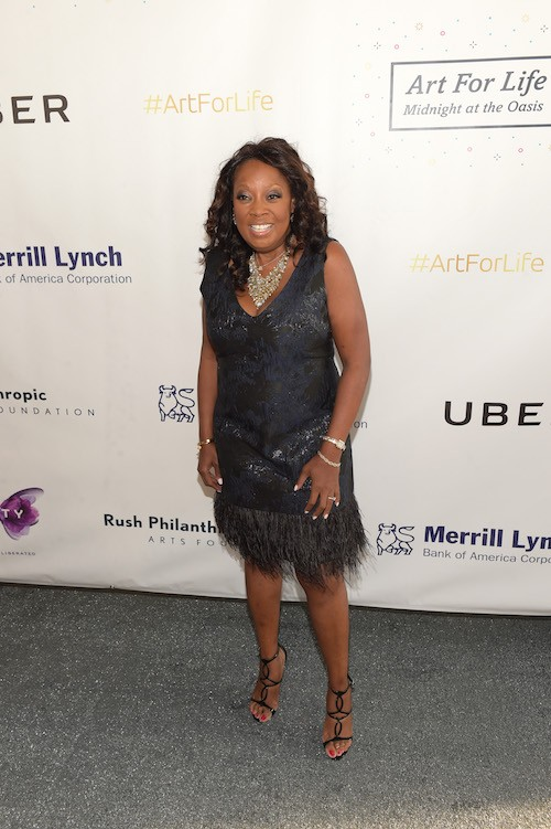 Star Jones posing for photographers at an event.
