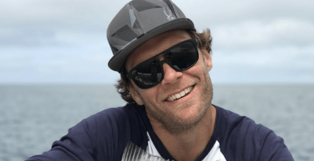 Steve Nyman smiling while on a boat.