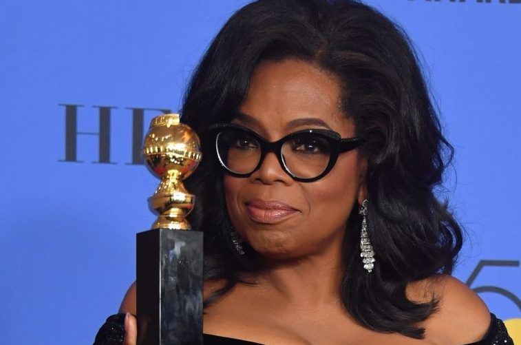 Actress and TV talk show host Oprah Winfrey poses with the Cecil B. DeMille Award during the 75th Golden Globe Awards