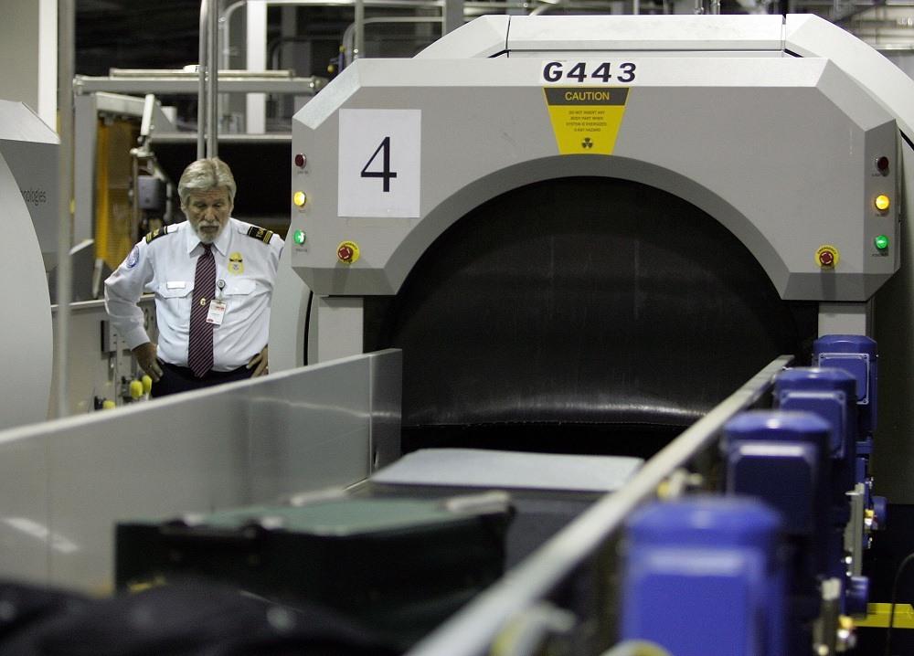 A Transportation Security Administration (TSA) worker monitors bags